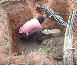 A-man-lays-Fibre-Optic-cable